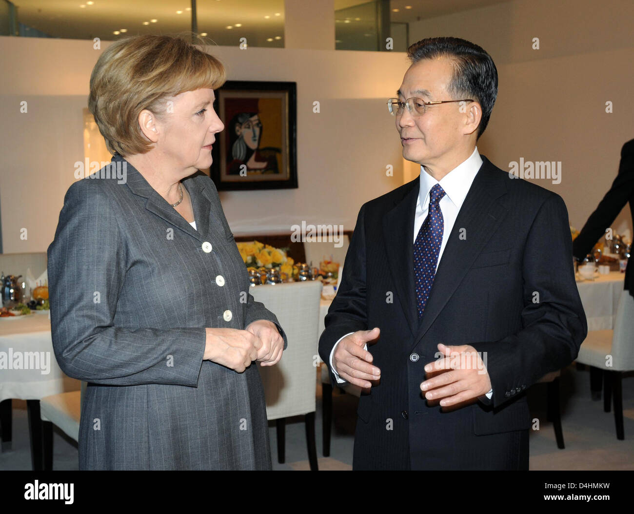German Chancellor Angela Merkel talks with Chinese Prime Minister Wen Jiabao during a working breakfast in Berlin, - Stock Image