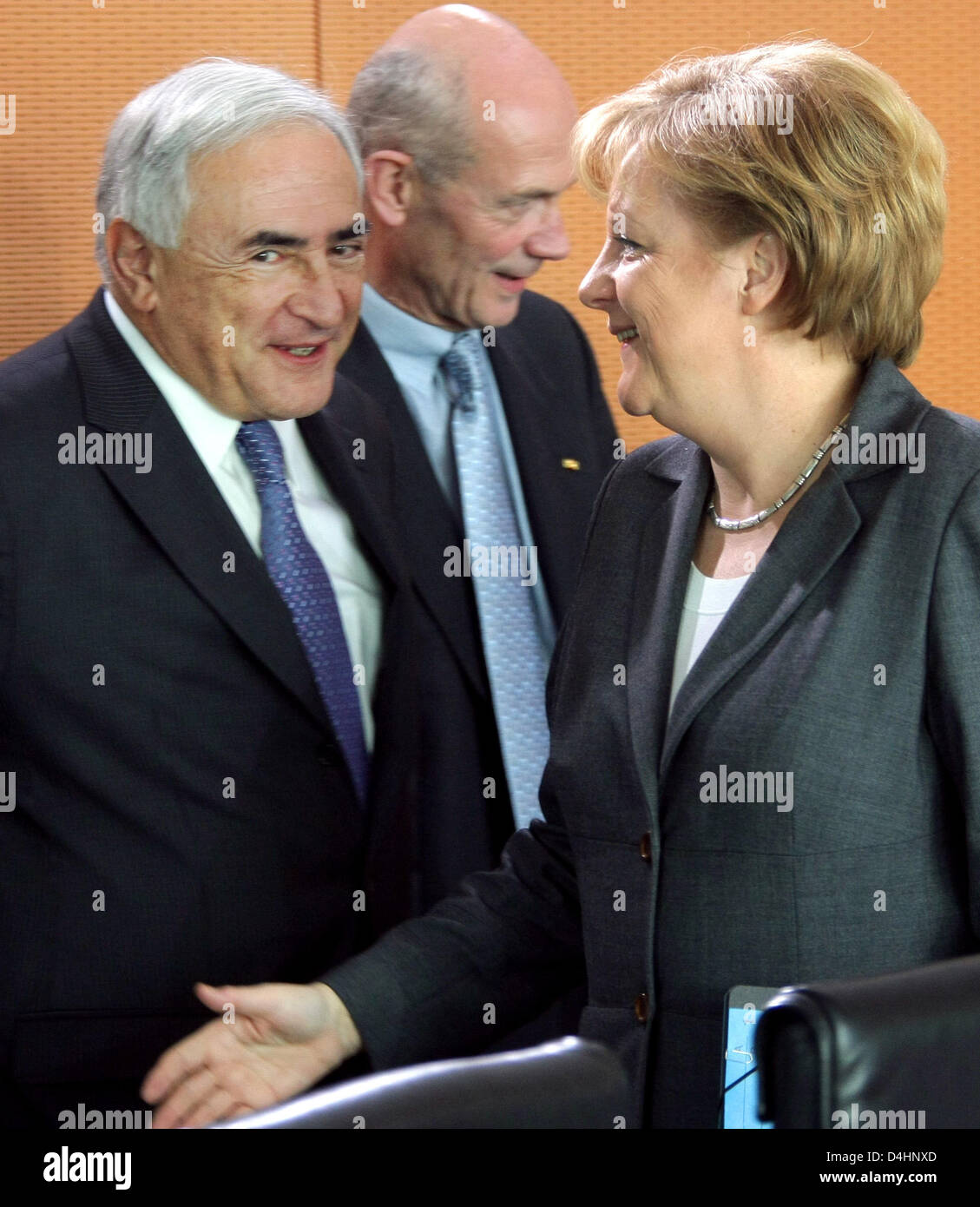 German Chancellor Angela Merkel (R) welcomes the Director of the International Monetary Fund (IMF), Dominique Strauss Stock Photo