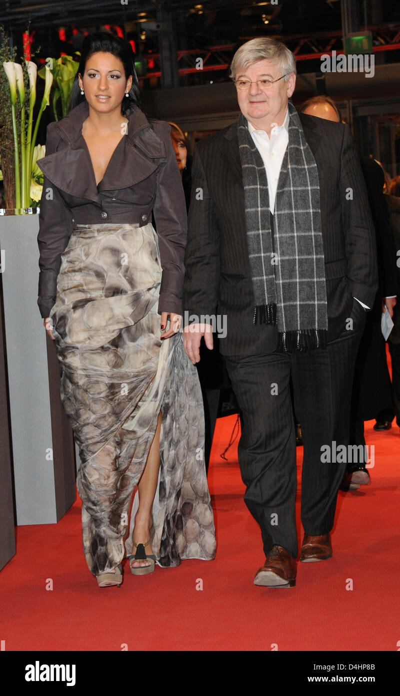 Former German Foreign Minister Joschka Fischer and his wife Minu Barati-Fischer arrive at the premiere of the film - Stock Image