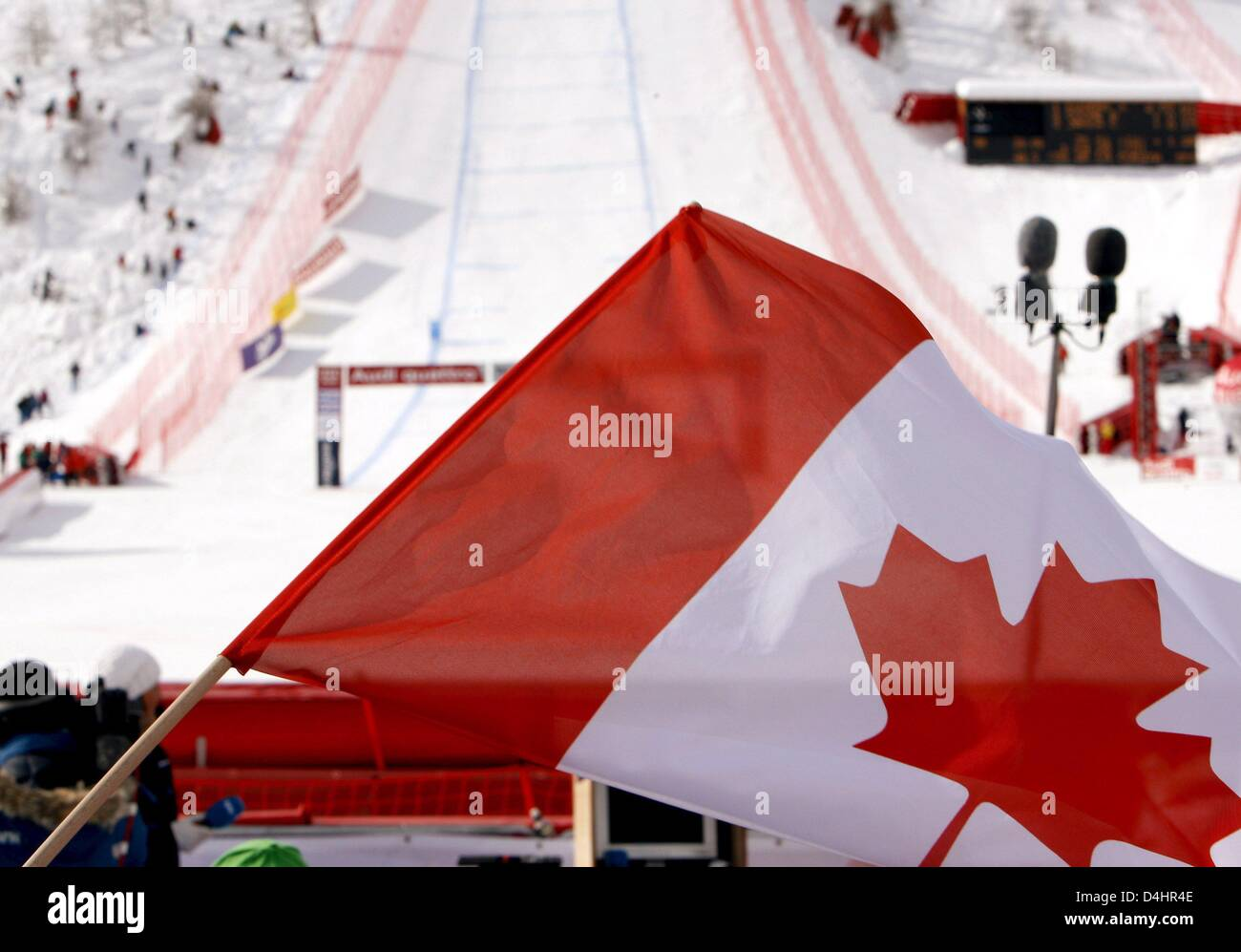 A Canadian flag is waved in the finish area during the Men?s Downhill competition at the Alpine Skiing World Championships - Stock Image