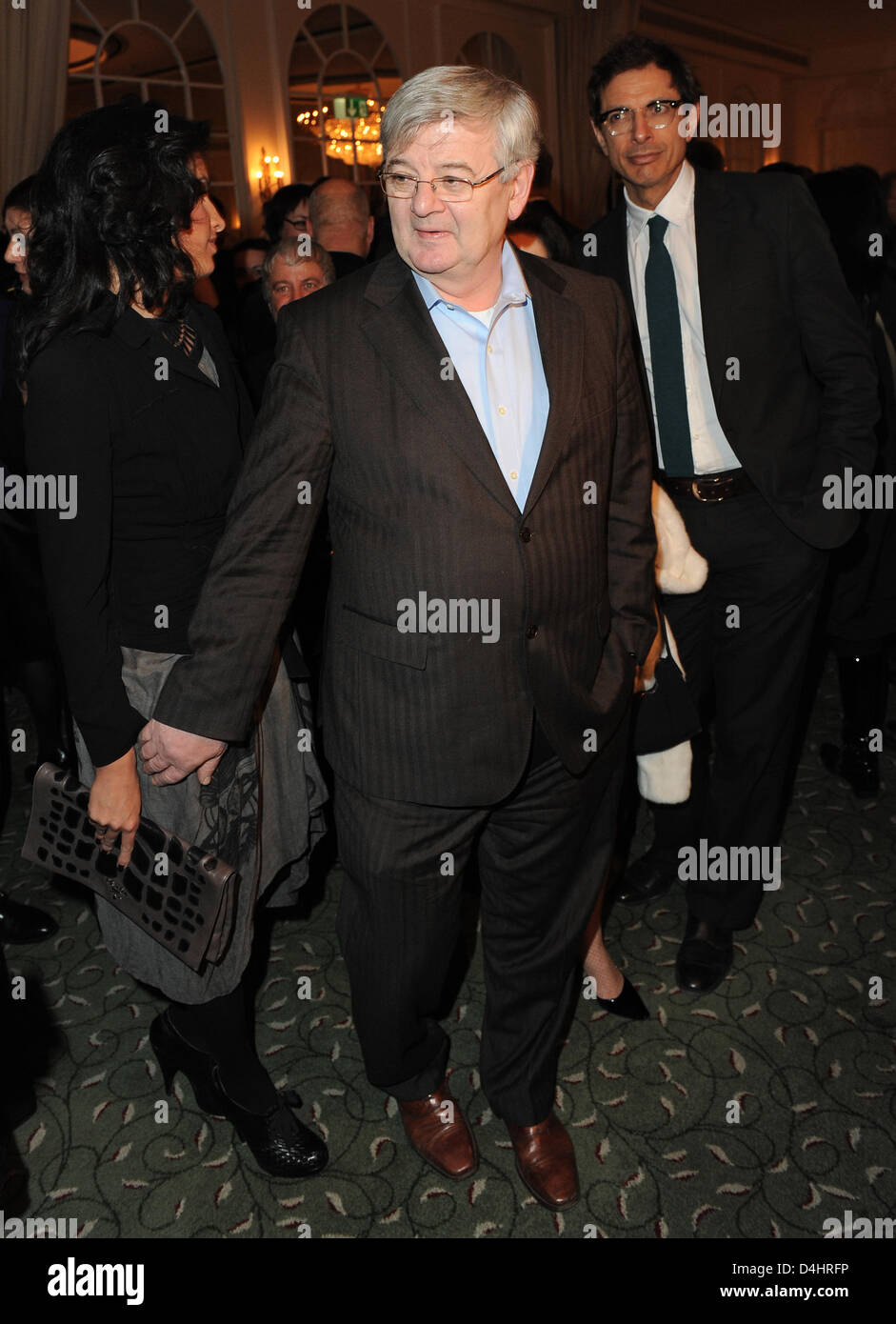 German former foreign minister Joschka Fischer (C) and his wife Minu Barati-Fischer (L) arrive for the afterparty - Stock Image