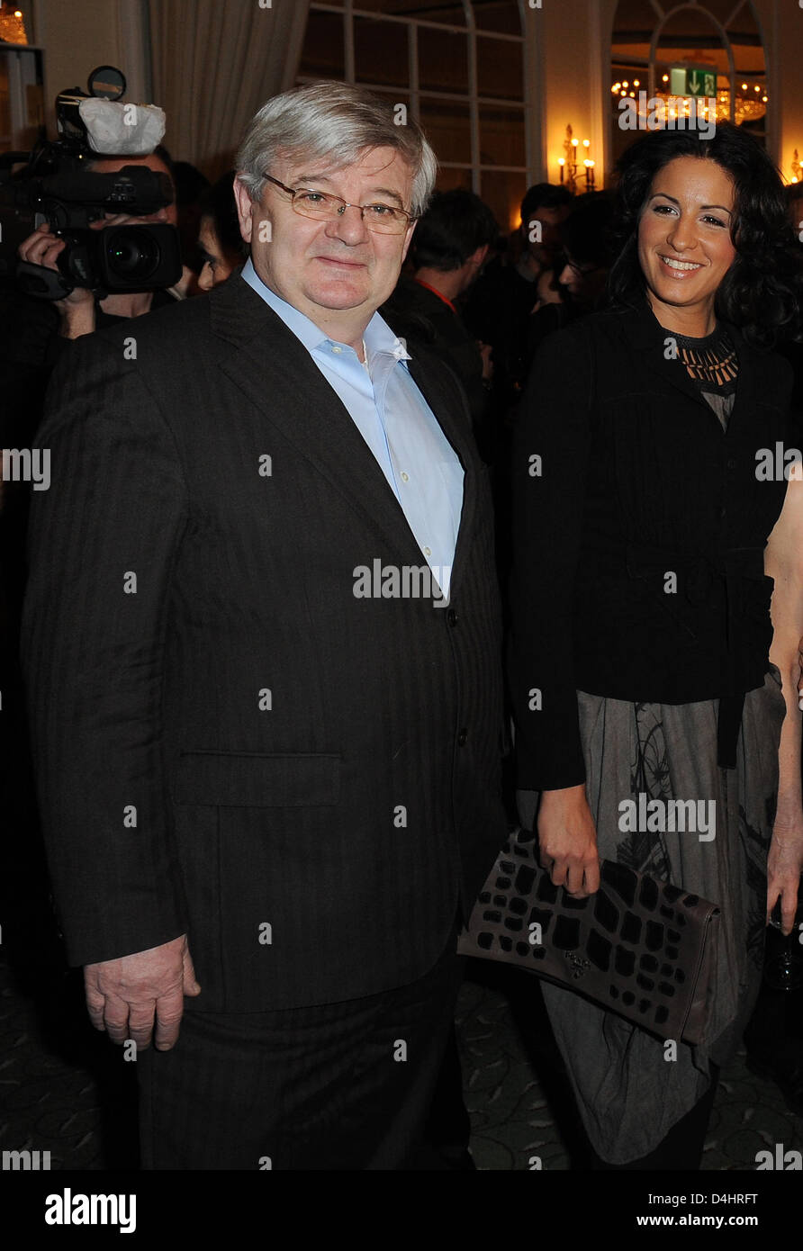 German former foreign minister Joschka Fischer (L) and his wife Minu Barati-Fischer (R) arrive for the afterparty - Stock Image
