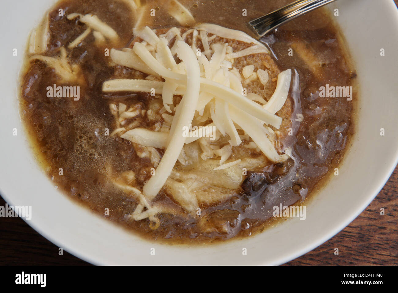 A plate of onion soup with toast and grated cheese - Stock Image