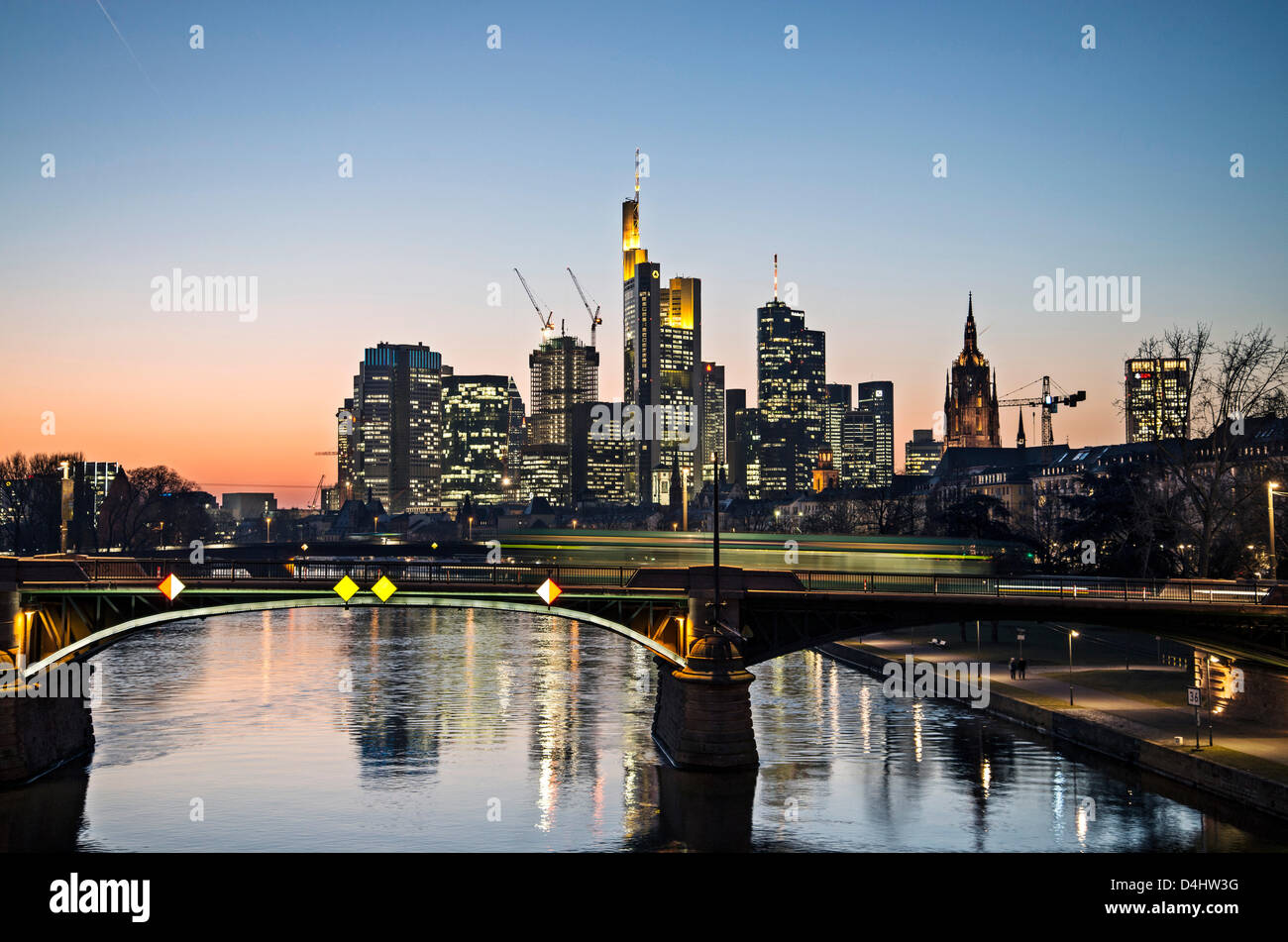 Frankfurt skyline at night with the river Main - Stock Image