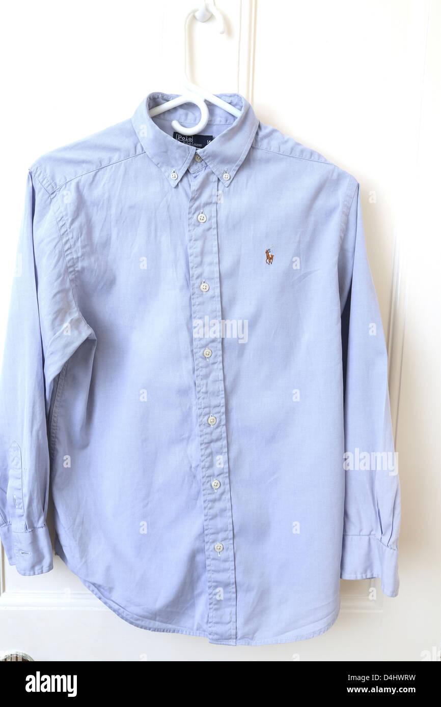 2c4d6ad8 Ralph Lauren Blue Polo Shirt Hanging On Door Stock Photo: 54483181 ...