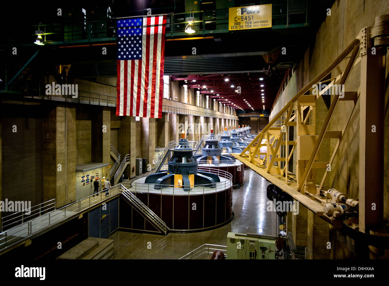An American flag decorates one of the hydroelectric power plants at Hoover Dam on the Colorado River Stock Photo