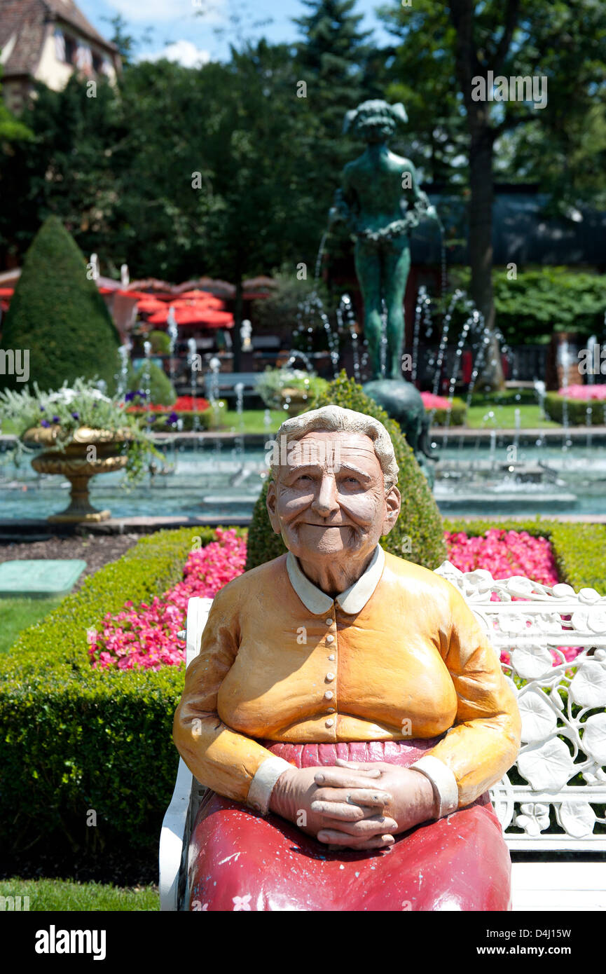Rusr, Germany, the figure of an old woman in the Europa-Park Rust - Stock Image