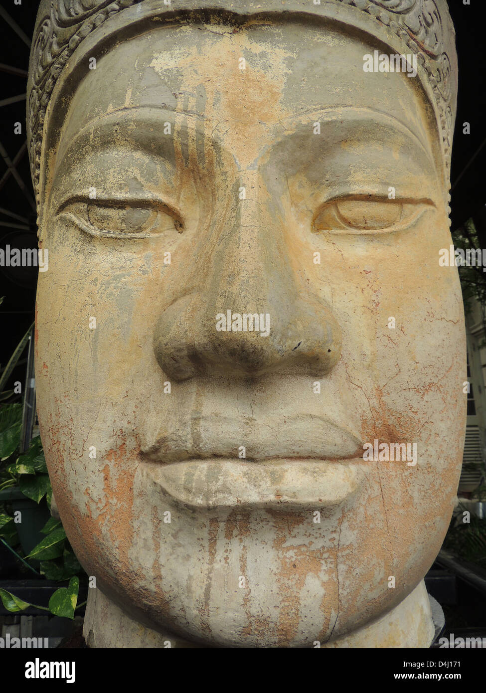 ASIATIC FACE sculptures outside a Singapore restaurant. Photo Tony Gale - Stock Image
