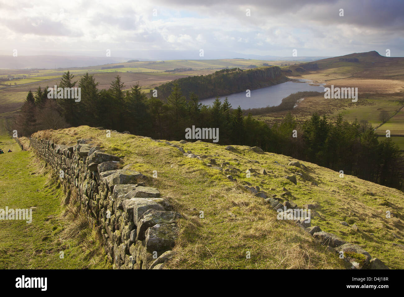 Hadrian's Wall from the top of Hot Bank Crags with Highshield Crags above Crag Lough in the distance Winshield - Stock Image