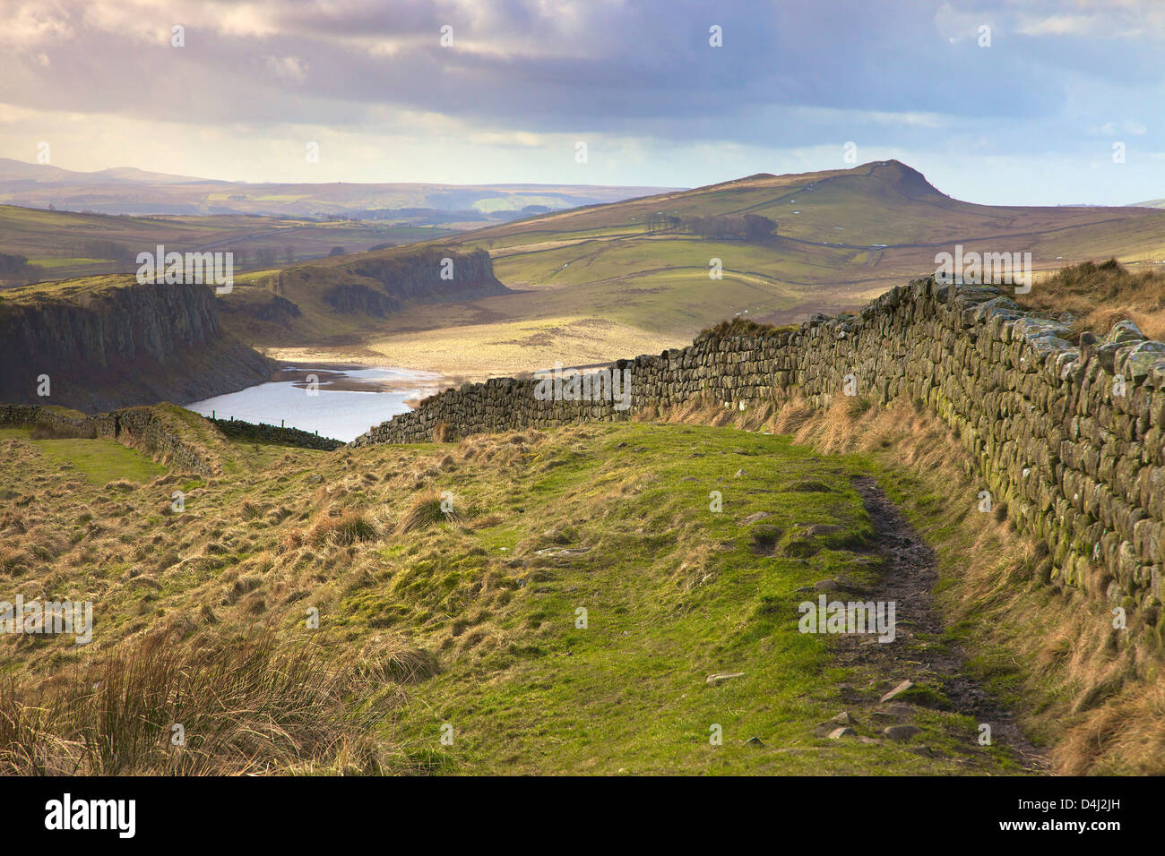 Hadrian's Wall from Hot Bank Crags with Highshield Crags above Crag Lough in the distance Winshield Crags  Northumberland - Stock Image