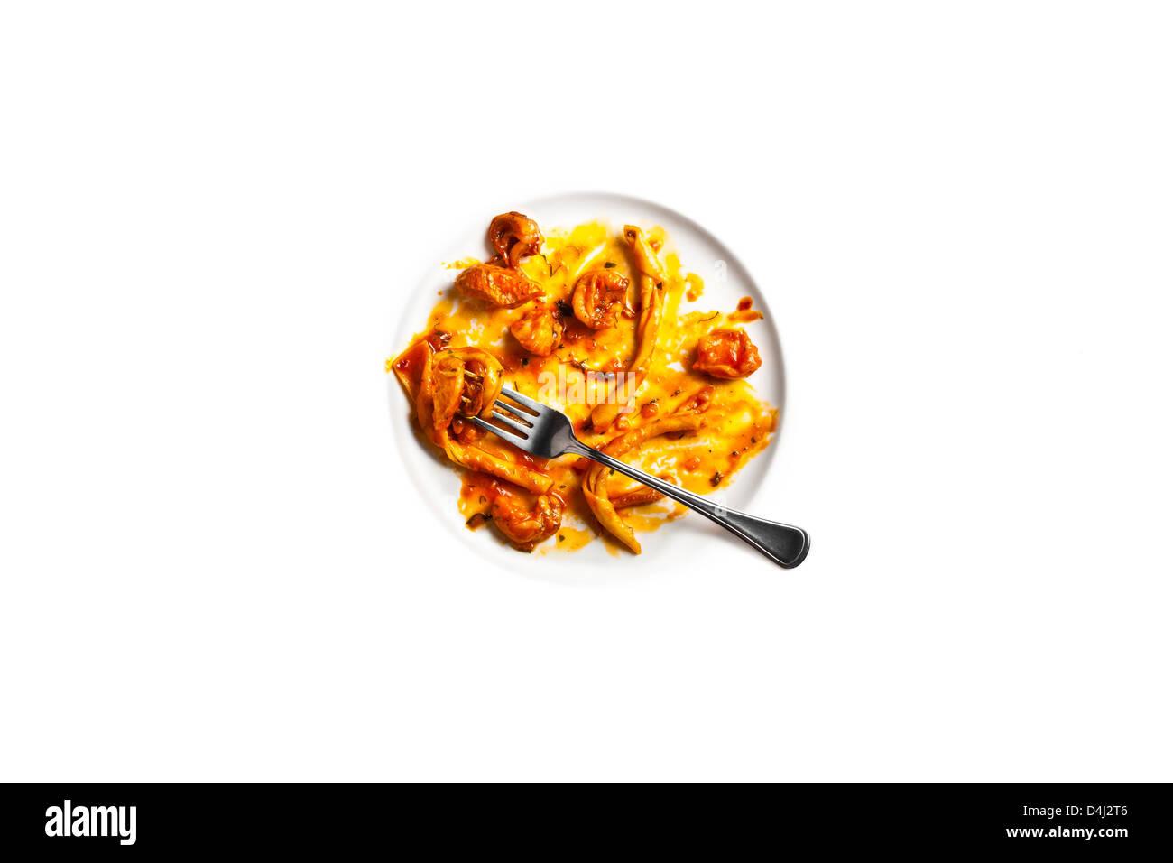 Strozzapreti con Brodetto di Pesce. Handmade pasta with a rich seafood and tomato stew. - Stock Image