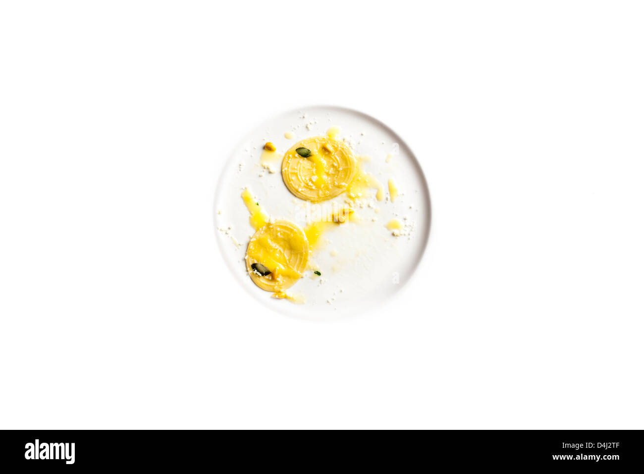 Corzetti - Stamped homemade pasta from the Liguria region of Italy served with butter, Marjoram and toasted pinenuts. - Stock Image