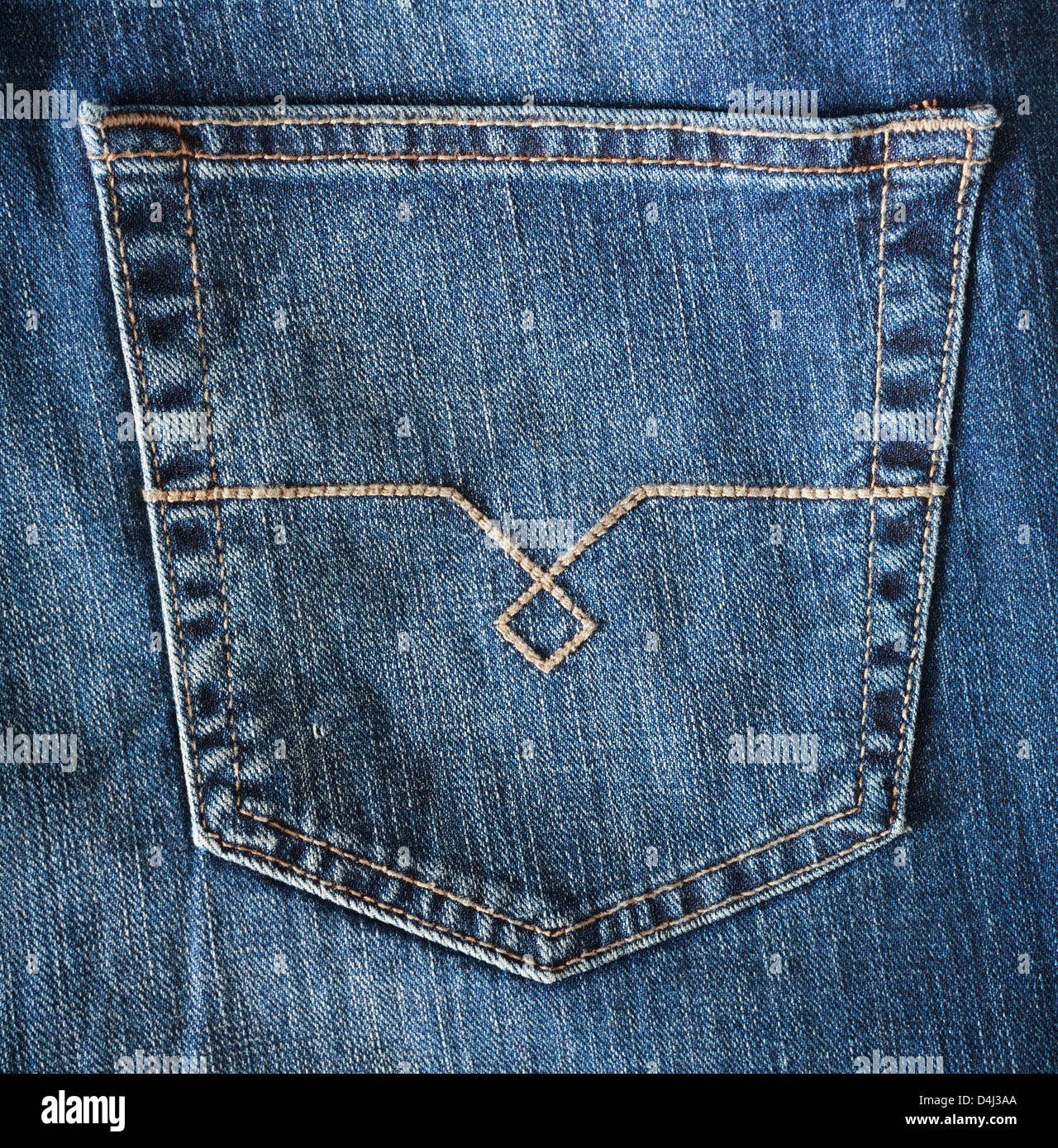 hip pocket on blue jeans, selective focus - Stock Image