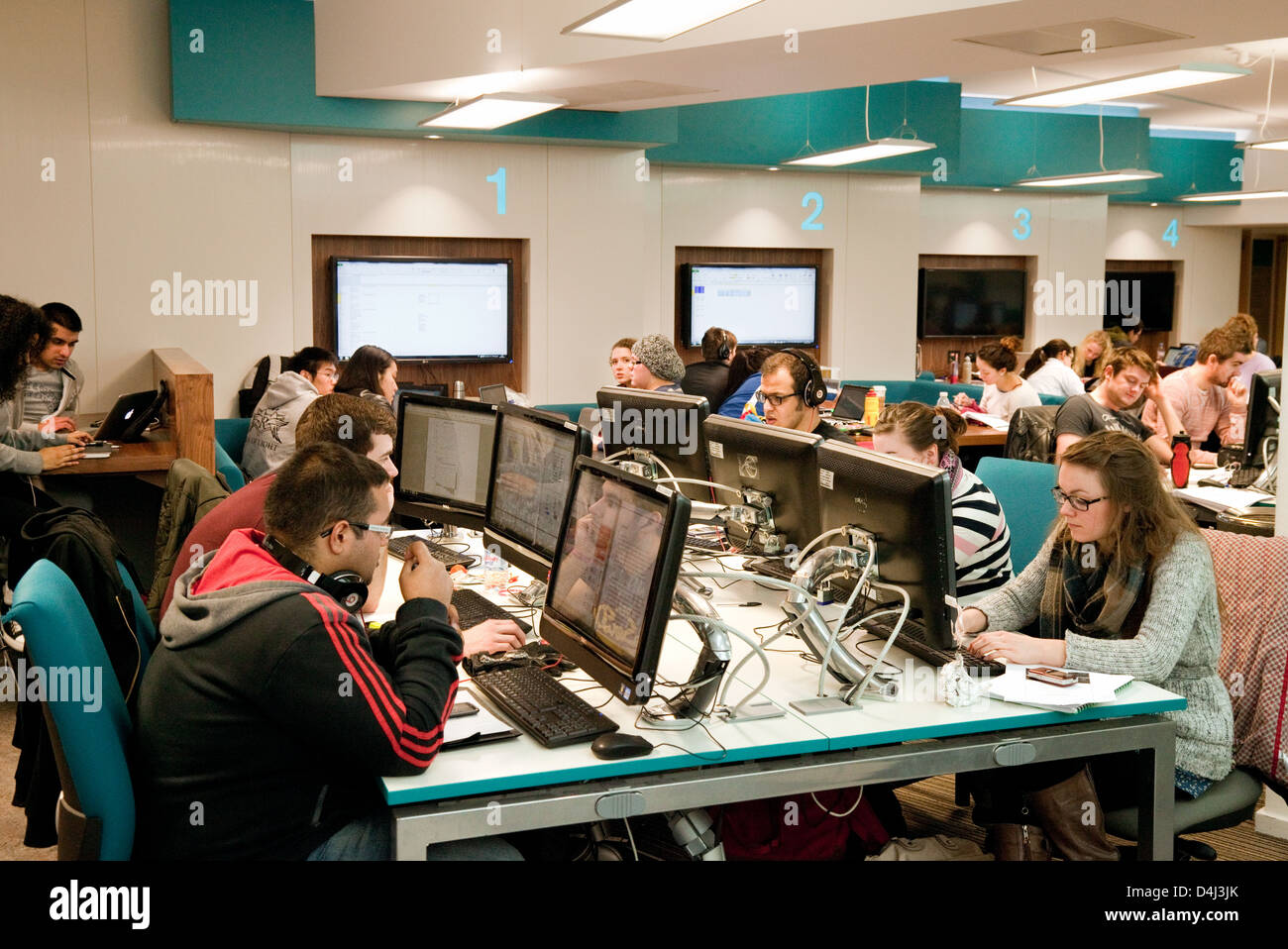 University students studying at their computers, Birmingham university, UK - Stock Image