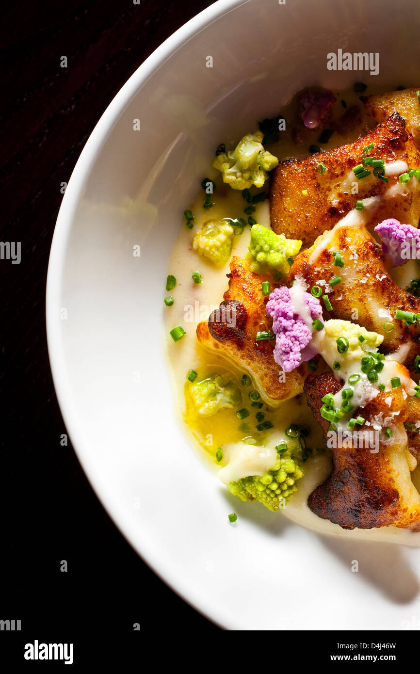 Loaded Gnocchi with Cauliflower and Chives prepared by Rob Ruban, Executive Chef of Crossbar in New York, NY. - Stock Image