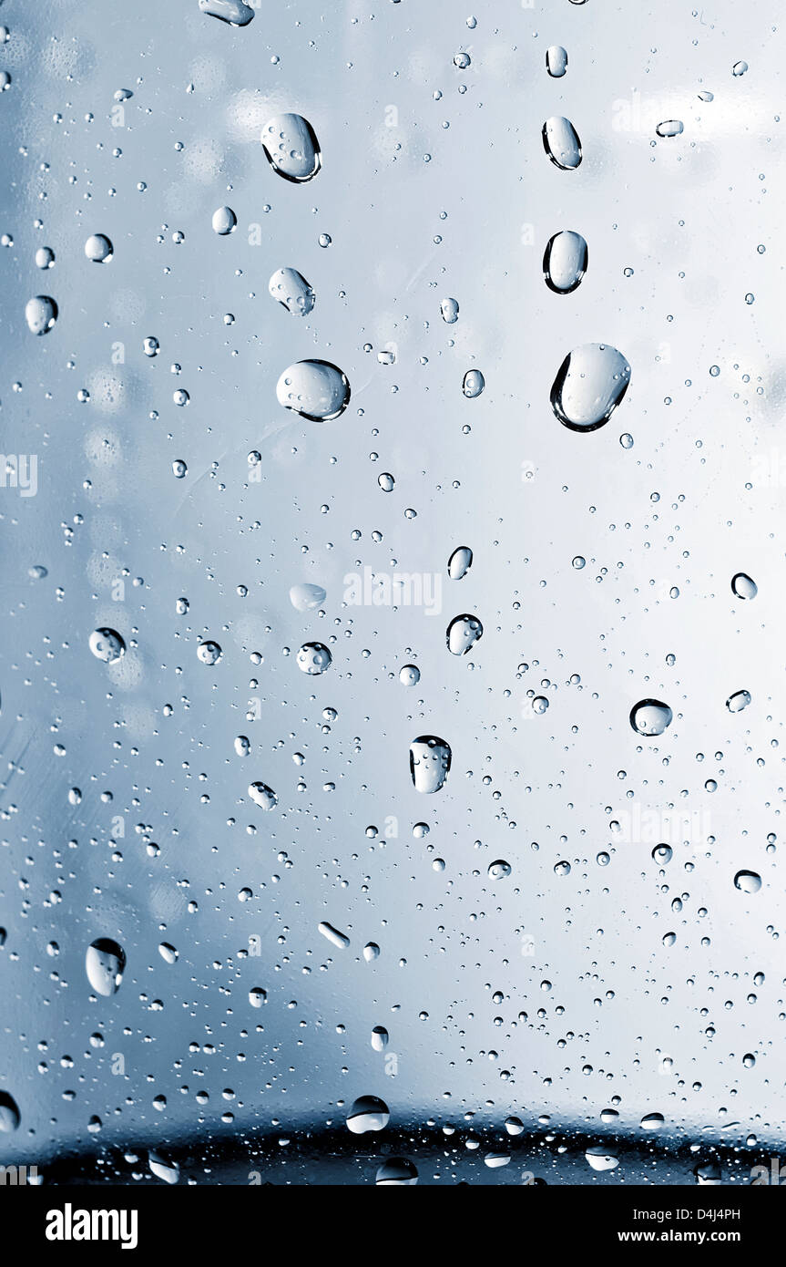 Close up to water drops on glass - Stock Image