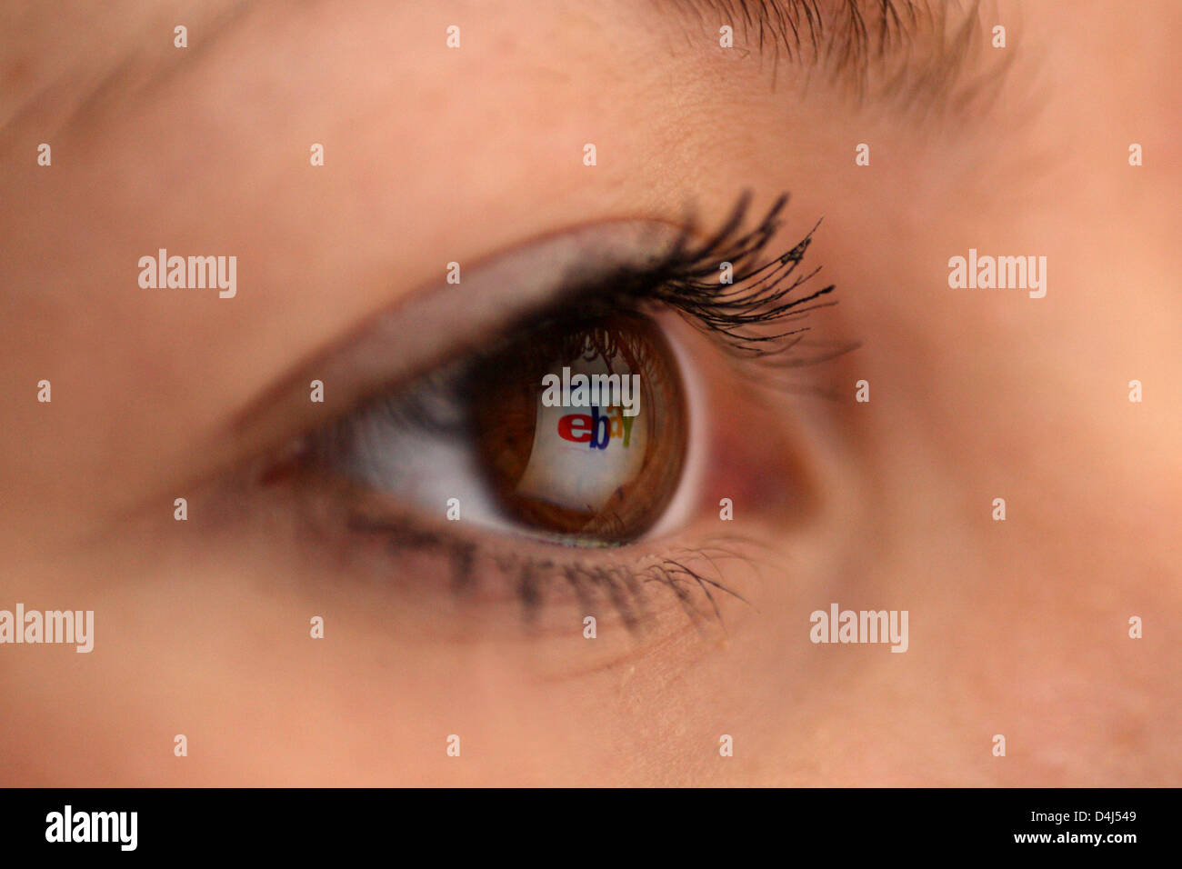 Berlin, Germany, mirroring the Ebay logo at the eye of a woman Stock Photo