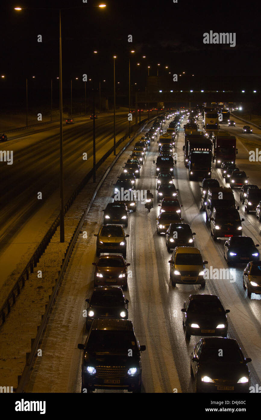 UK Traffic delays on a motorway because of bad snow - Stock Image