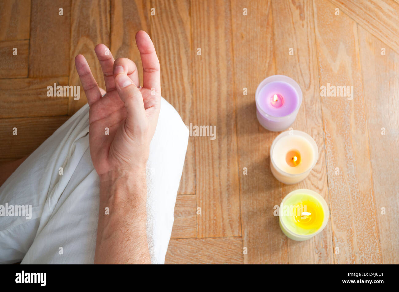 Man practicing yoga, sitting in the lotus position. Close view. - Stock Image