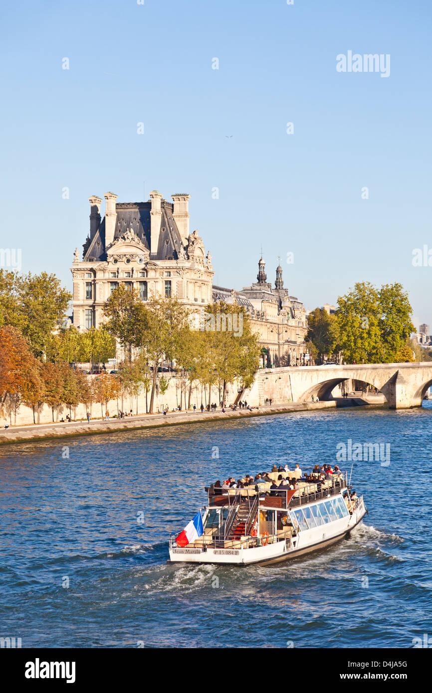 Tourists on the motor launch Jean Marais, owned by Bateaux Parisiens, travelling along the River Seine,central Paris - Stock Image