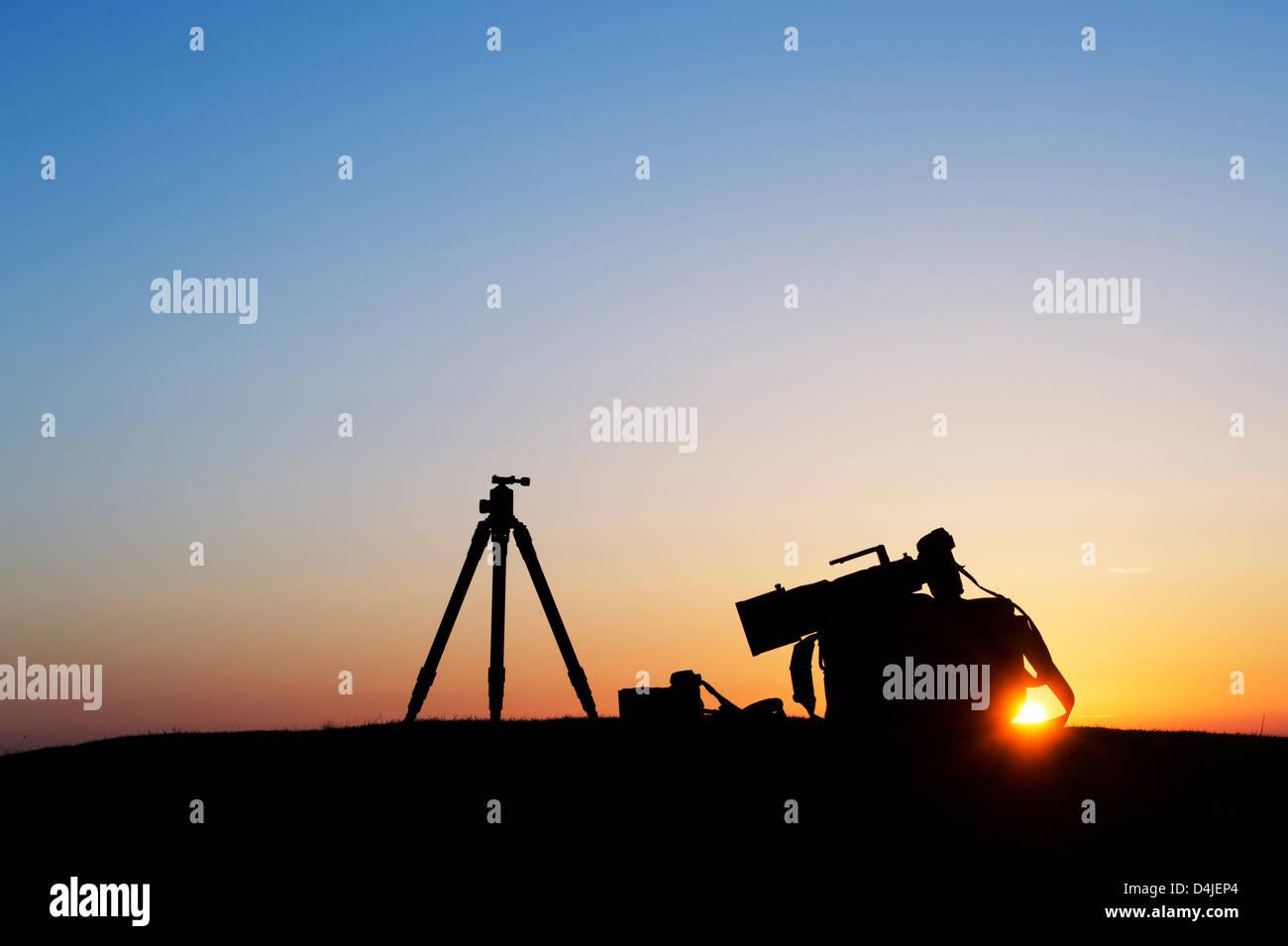Camera equipment at sunrise. Silhouette - Stock Image