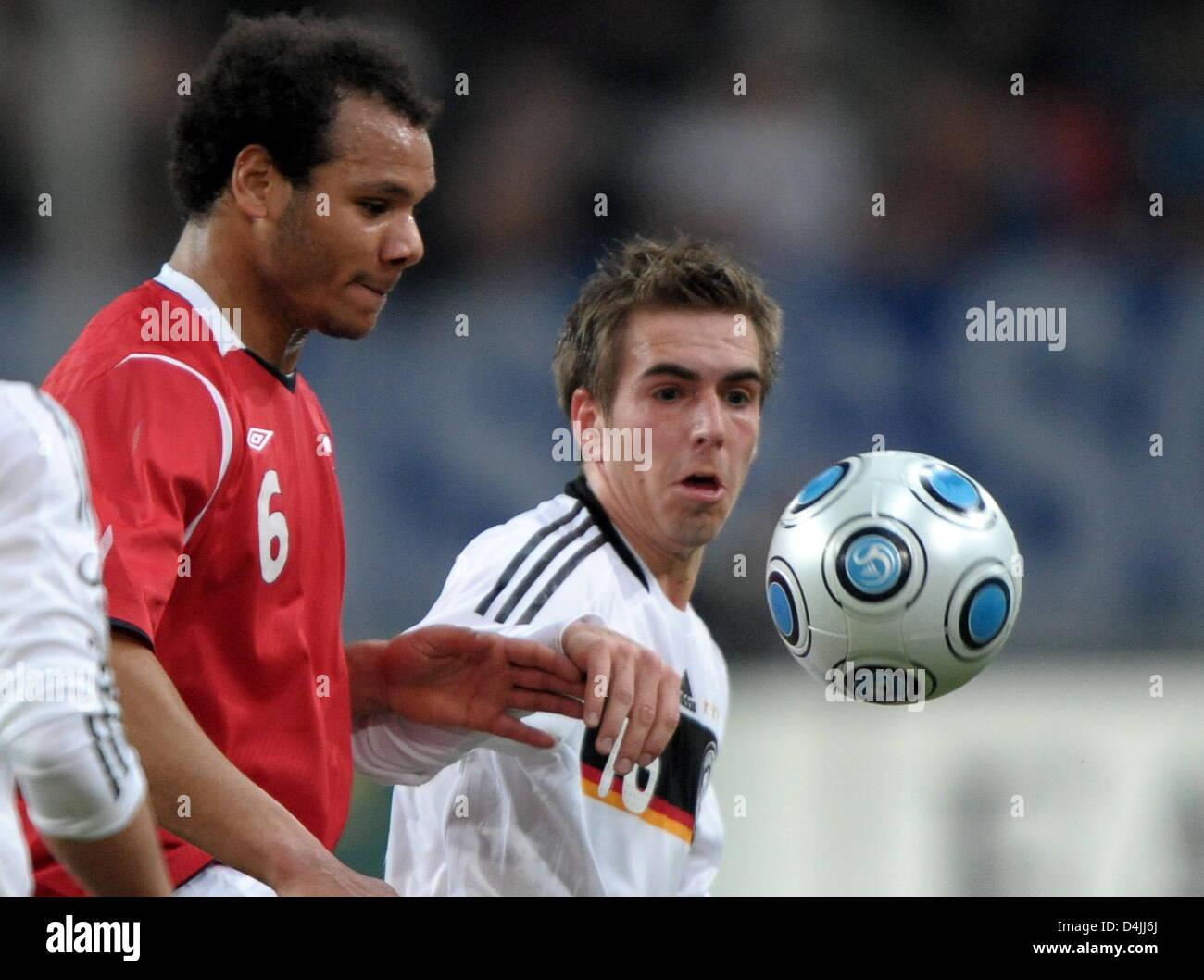 Germany?s Philipp Lahm (R) and Norway?s Daniel Braaten seen