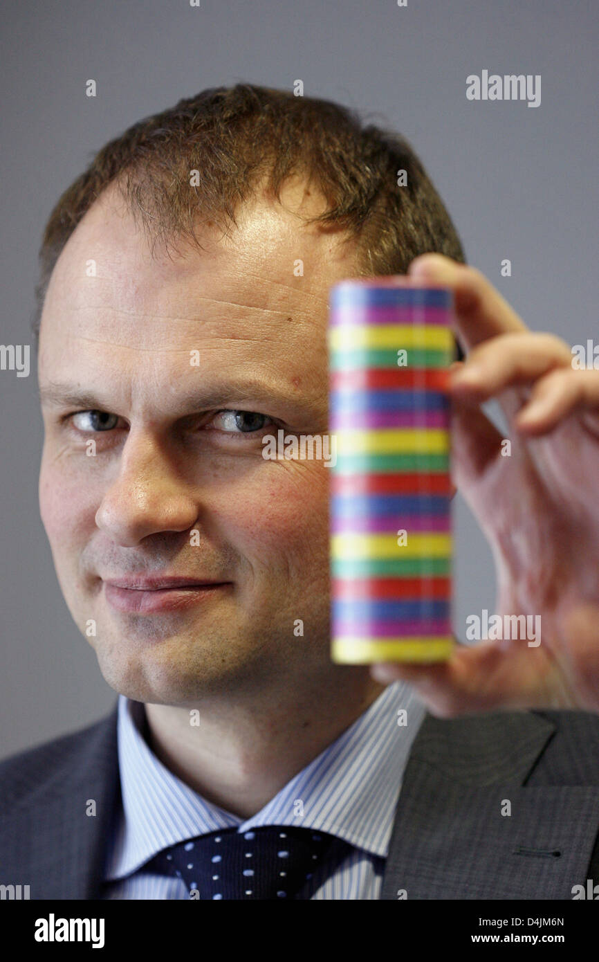 Authorised officer of paper processing company Franz Veit GmbH, Rainer Buld, poses with a paper streamer in Hirschaid, - Stock Image