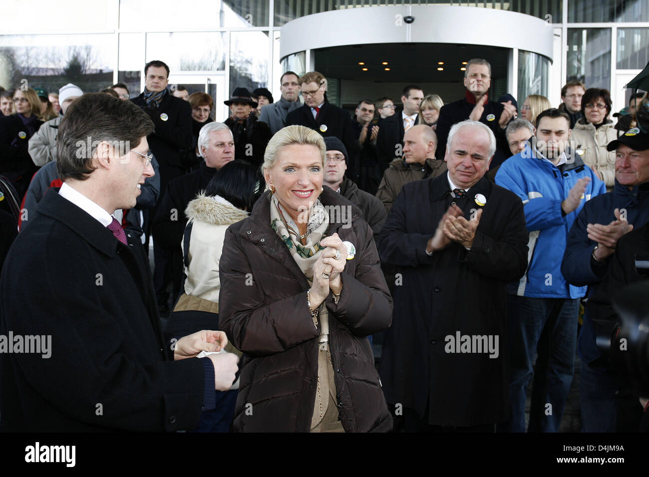 Maria-Elisabeth Schaeffler (C), owner of auto supplier Schaeffler Group, welcomes demonstrators at the plant gate - Stock Image