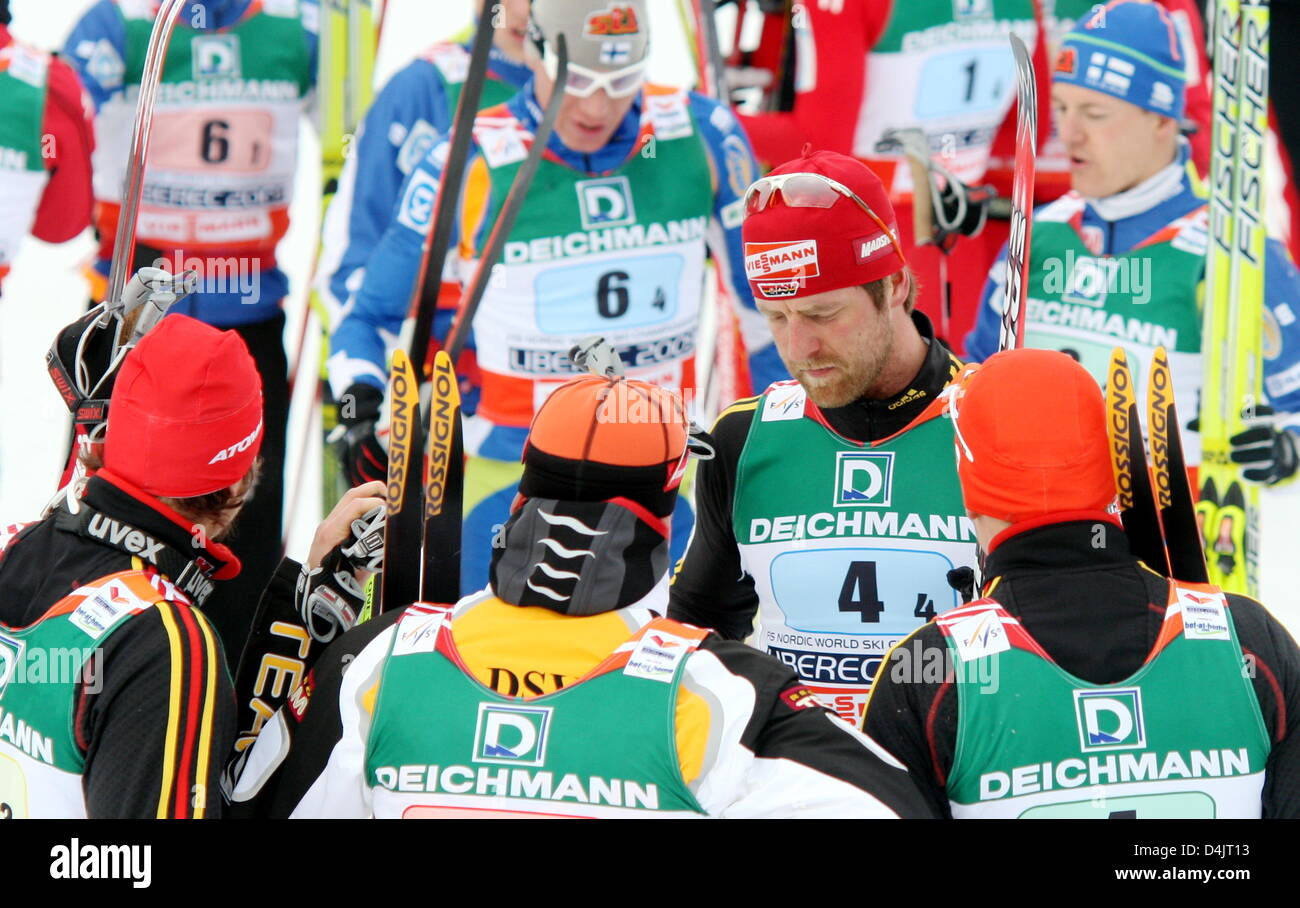 Germany?s Axel Teichmann is consoled after the men?s cross-country skiing relay competition at the FIS Nordic World - Stock Image