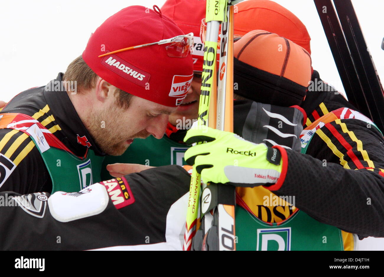 Germany?s Axel Teichmann (L) is consoled by his team-mates after the men?s cross-country skiing relay competition - Stock Image
