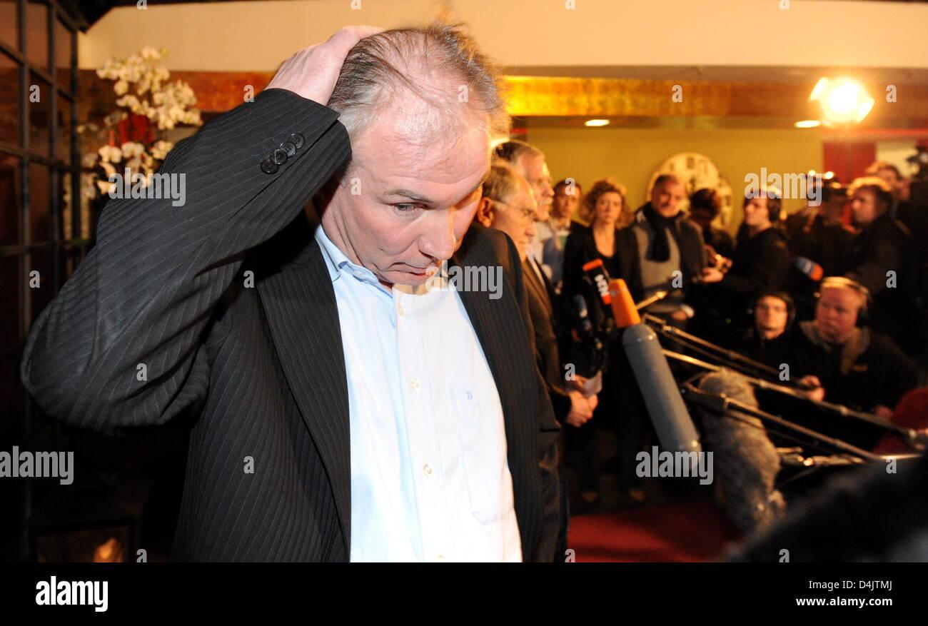 Uwe Schwenker, managing director of German handball club THW Kiel, gestures during a crisis meeting of Handball - Stock Image