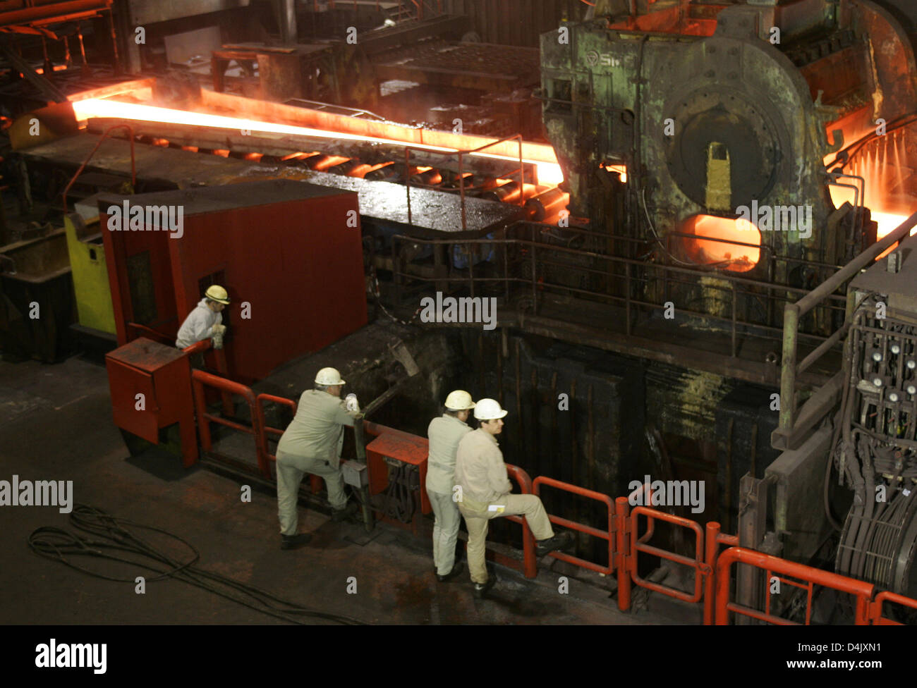Steel workers supervise the steel production at ThyssenKrupp in Duisburg, Germany, 02 March 2009. Pig iron is mixed - Stock Image