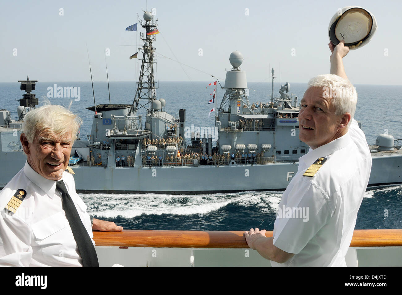 Traumschiff Cp Loveboat And Captain Of Ms Deutschland Andreas Junghblut R Pose On The Bridge Of Cruise Liner Ms Deutschland As German Navy