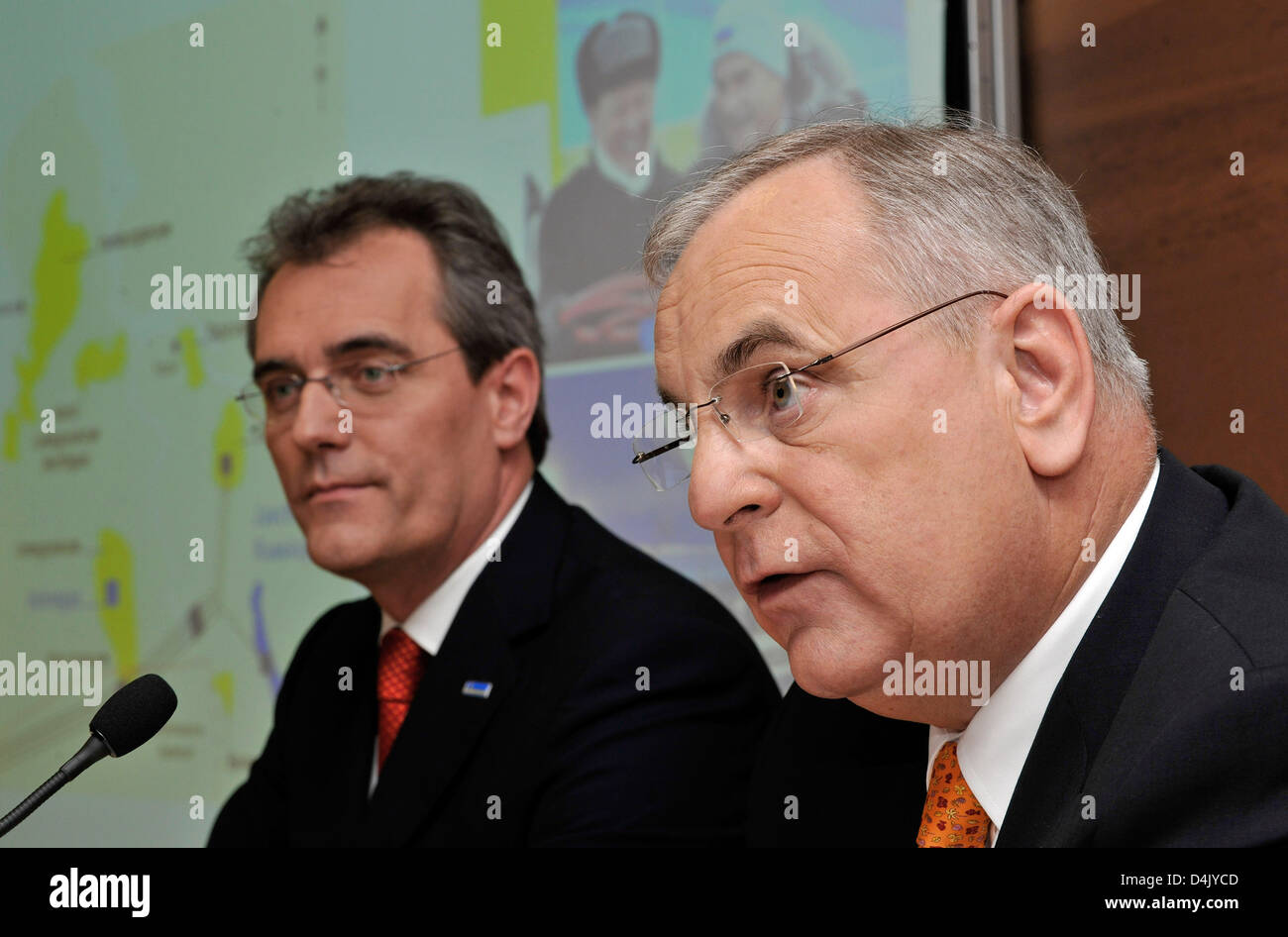 Wintershall Holding CEO Reinier Zwitserloot (R) speaks next to board member Rainer Seele (L) at the group?s annual - Stock Image