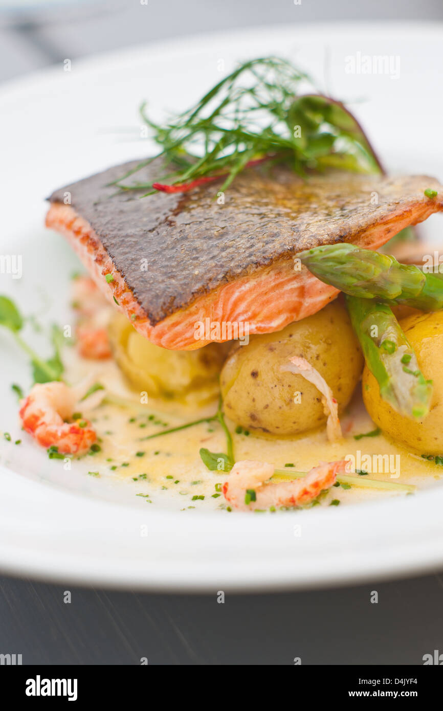Plate of fish with potatoes - Stock Image