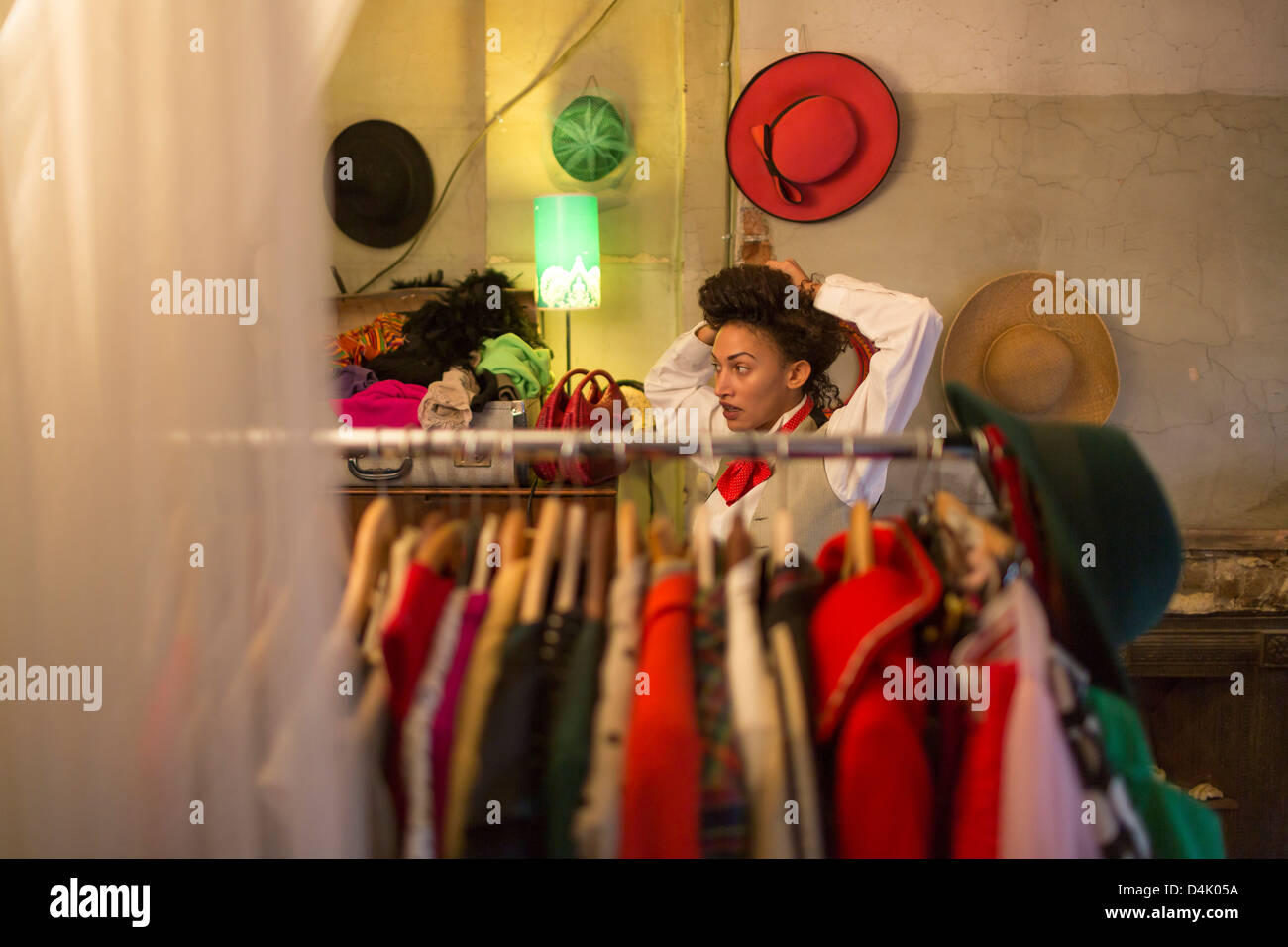 Woman shopping in clothes shop - Stock Image