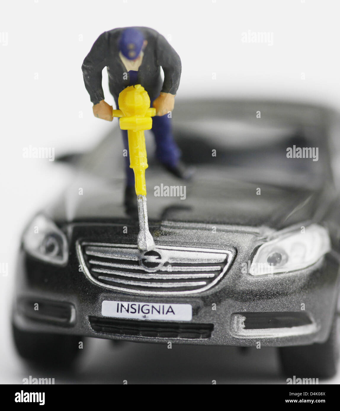 The picture dated 11 March 2009 shows a model railway figure with a jackhammer standing on the engine bonnet of - Stock Image