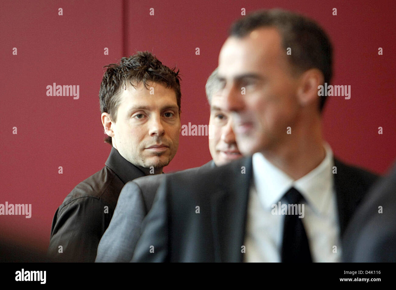 Peter Geigle (L), suspended doping appointee of Bundesliga club 1899 Hoffenheim and his solicitors arrive at the - Stock Image