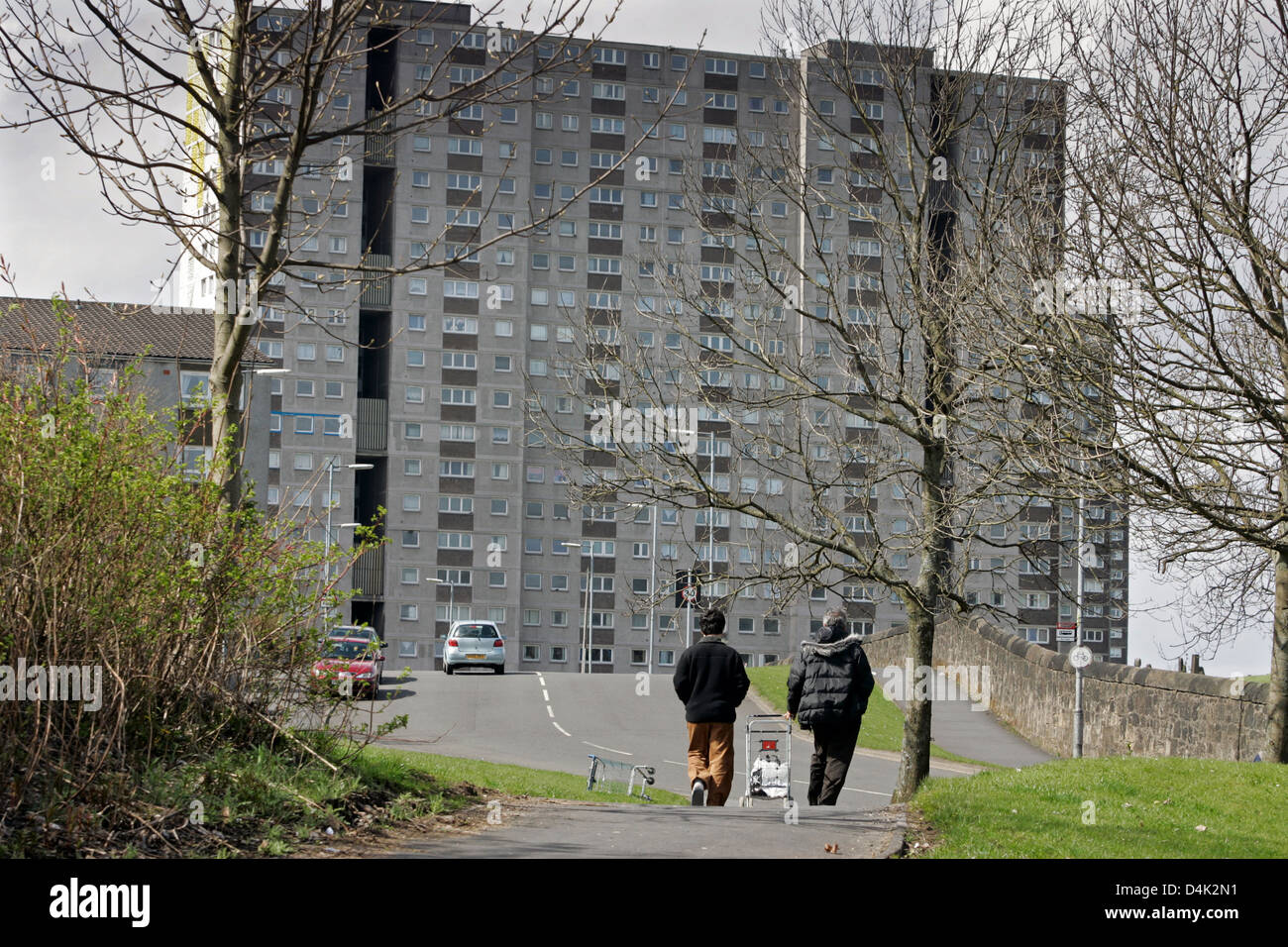 Asylum seekers make there way home to their temporary accommodation in the Sighthill area of Glasgow, Scotland - Stock Image