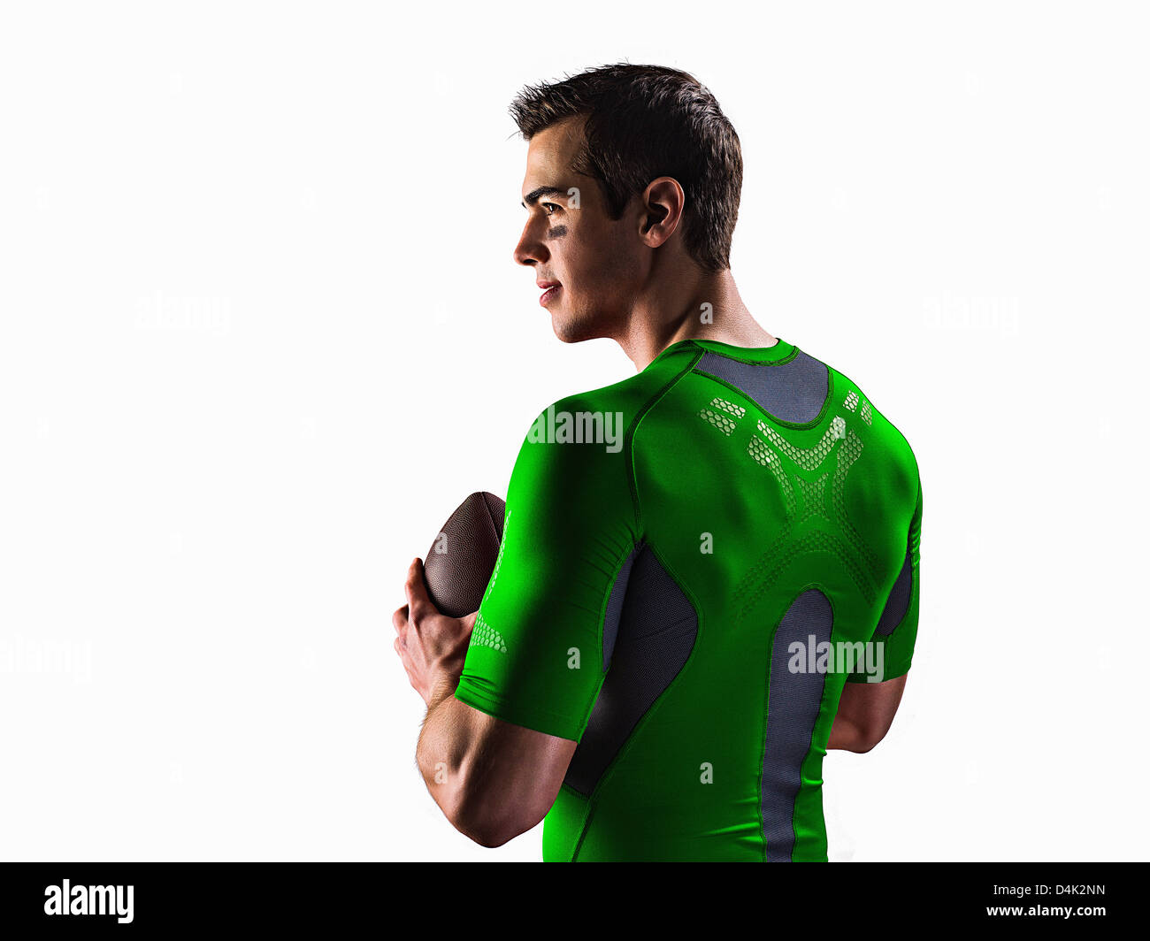 Athletic man holding football Stock Photo