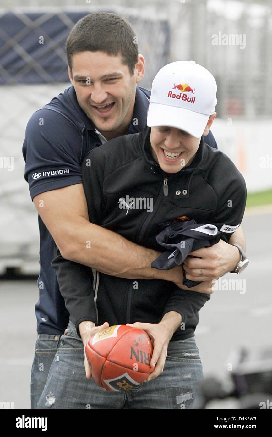 German Formula One driver Sebastian Vettel (R) of Red Bull Racing-Renault poses with Australian footie player Brendan - Stock Image