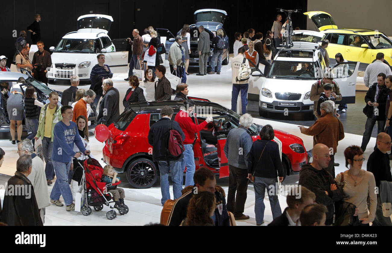 Visitors seen at the exhibition stand of skoda during the car fair ...