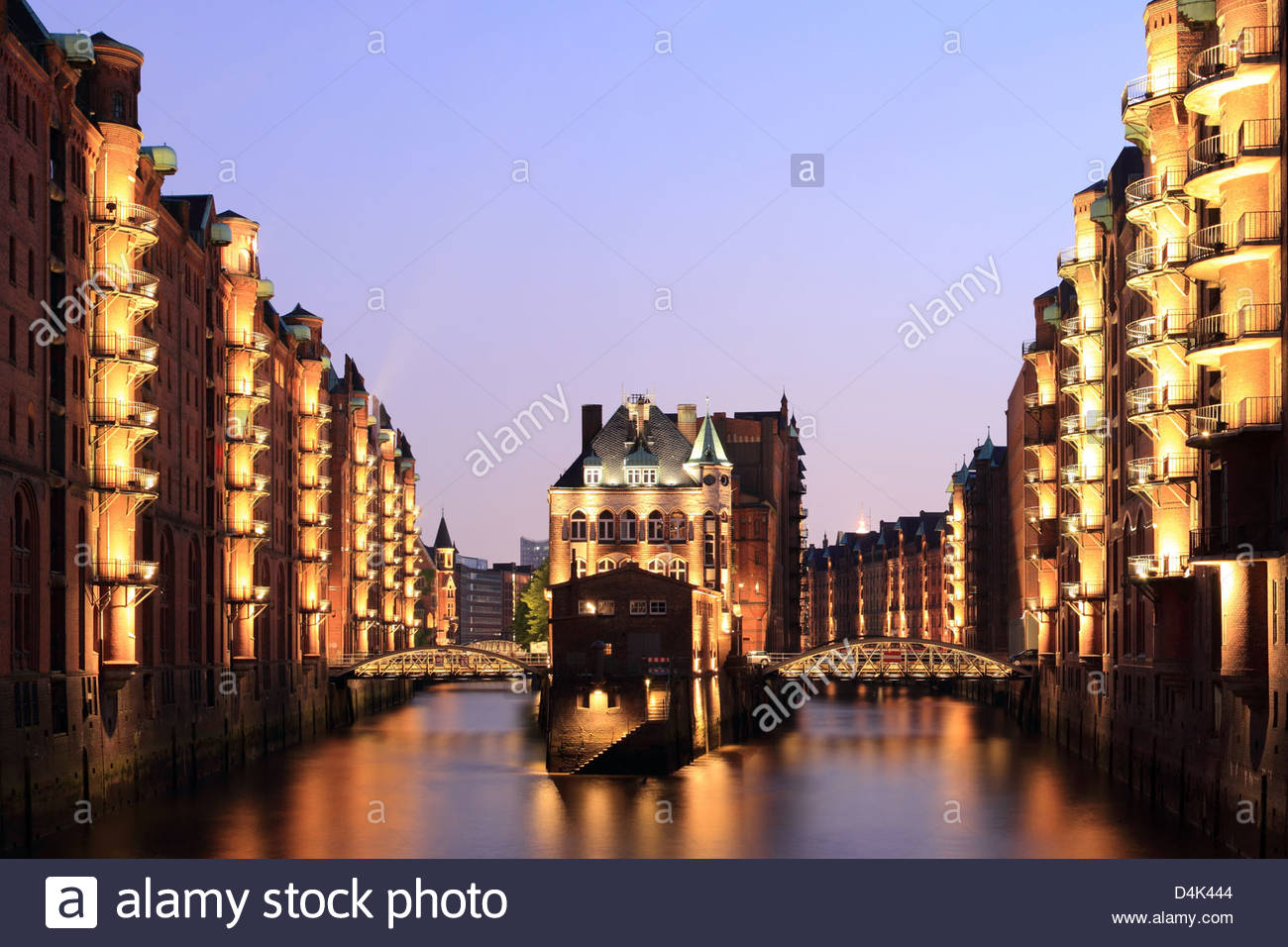 Buildings on river illuminated at night - Stock Image