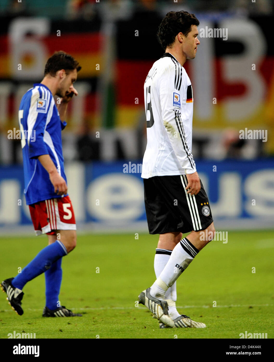Germany?s team captain Michael Ballack (R) and Liechtenstein?s Andreas Gerster leave the field after the first halftime - Stock Image