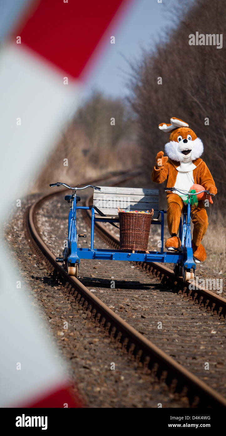 An Easter bunny rides the rail trolley of the adventure railway in Zossen, Germany, 31 March 2009. The 40 kilometres - Stock Image