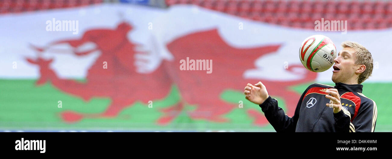 Germany?s Per Mertesacker heads the ball during the squad?s final training session at ?Millennium Stadium? in Cardiff, Stock Photo