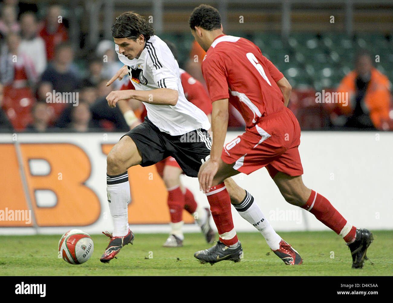 Germany?s Mario Gomez vies for the ball with Wales? Lewin Nyatanga during the World Cup qualifying match Wales vs Stock Photo