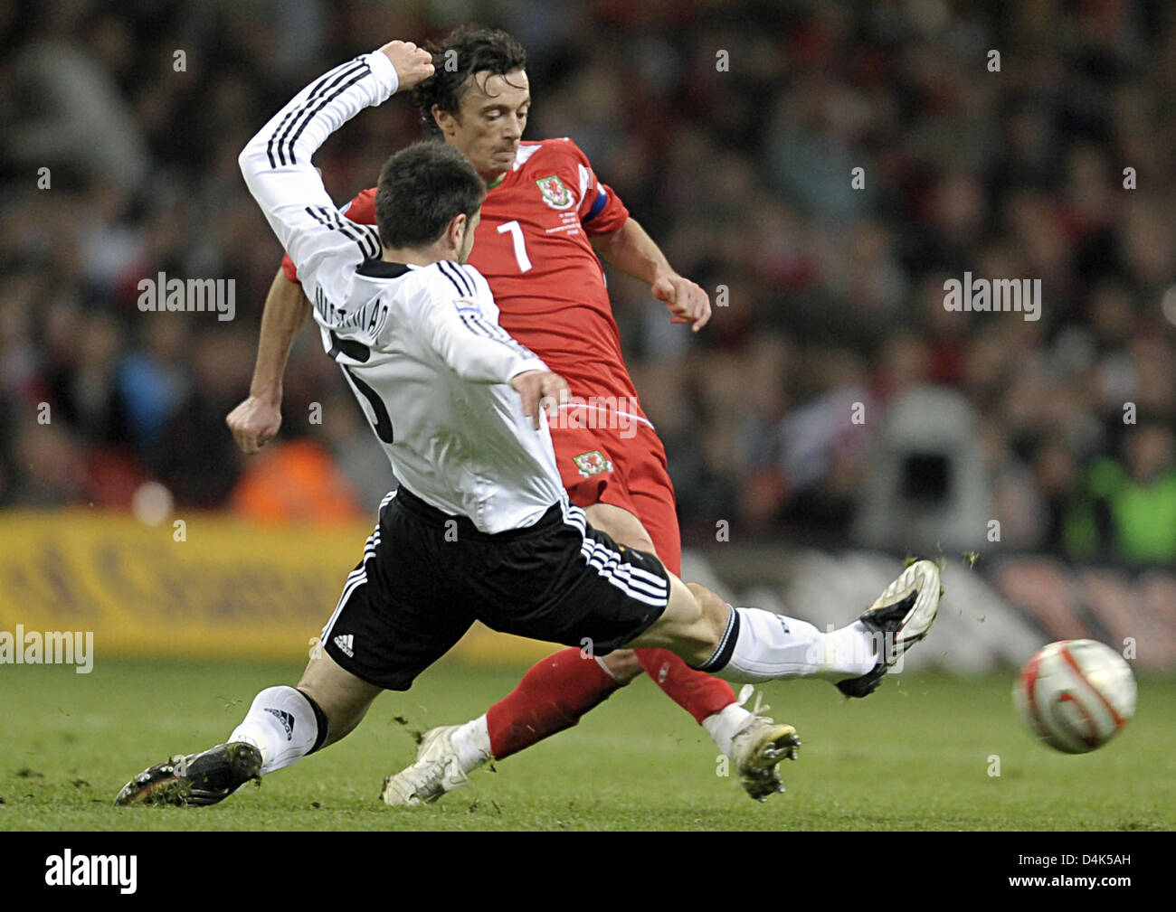 Germany?s Heiko Westermann (L) vies for the ball with Wales? Simon Davies during the World Cup qualifying match Stock Photo
