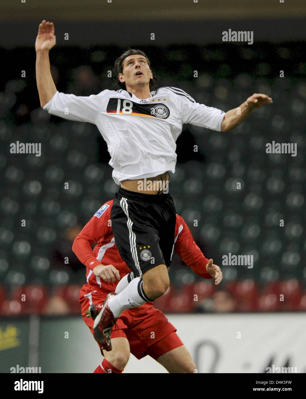 Germany?s Mario Gomez jumps for the ball during the FIFA 2010 World Cup qualifier Wales vs Germany at Millenium Stock Photo