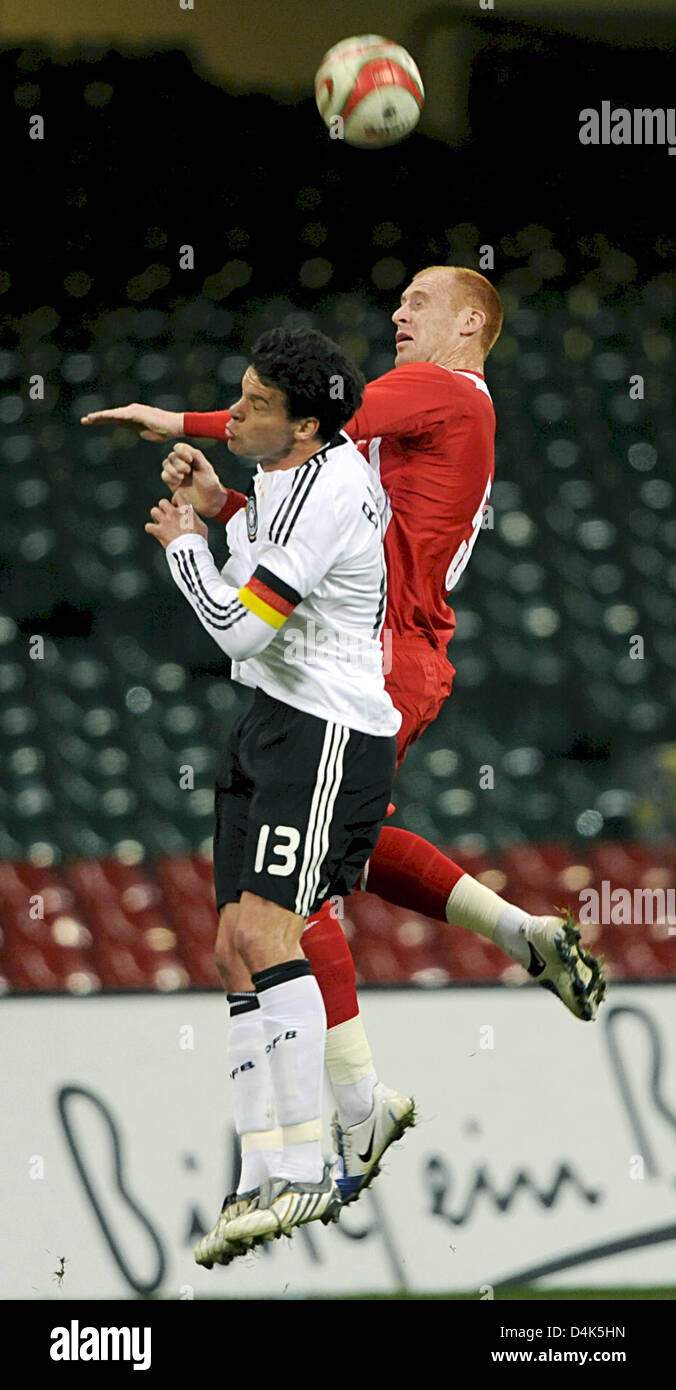 Germany?s captain Michael Ballack (L) fights for the ball with Wales? James Collins during the FIFA 2010 World Cup Stock Photo